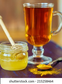 Cup of tea with honey and turmeric for  detox drink