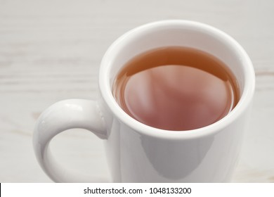 Cup of tea isolated on white wooden  background.