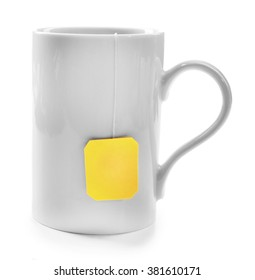 Cup of tea isolated on white background. Teabag with yellow label