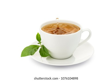 cup of tea with leaves and drop splashing, on white background