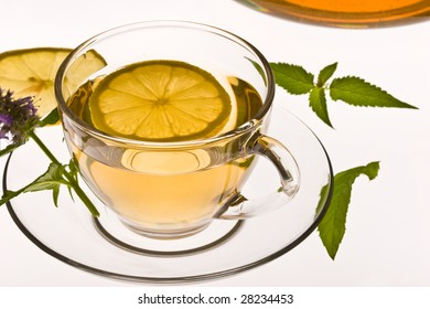 cup of tea with  leaves of mint