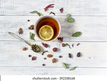 Cup of tea with lemon top view