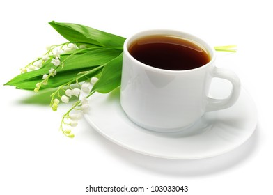 Cup of tea and lilies of the valley on a white background