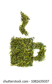 Cup of tea made of sencha green tea leaves isolated on white