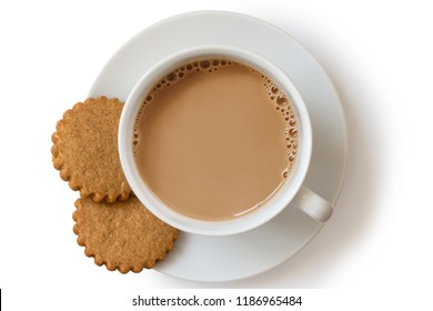 A cup of tea with milk and two gingerbread biscuits isolated on white from above. White ceramic cup and saucer.
