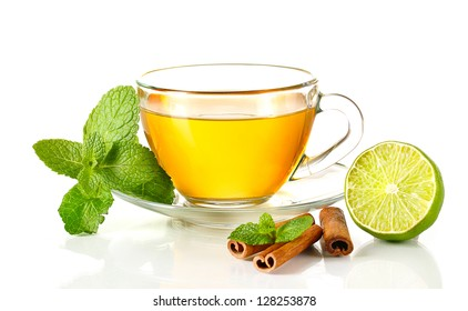 Cup of tea with mint,cinnamon and lime isolated on white