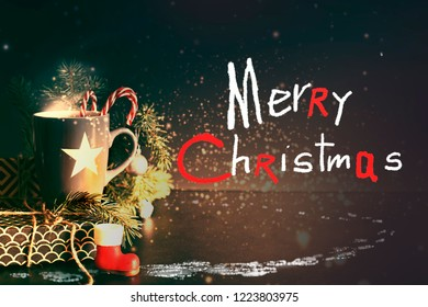 Cup of Tea on Christmas background with snow in rustic style with copyspace