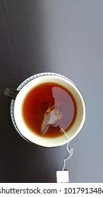 cup of tea on dark background. top view. space for text