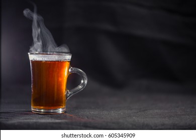 the Cup of tea on a dark background.