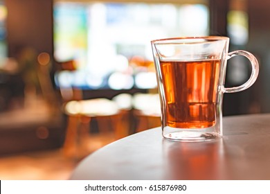 A cup of tea on table with beautiful background and copy space