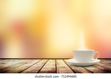 Cup with tea on table over blur bokeh nature background