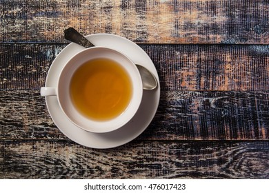 Cup of tea on vintage wooden background