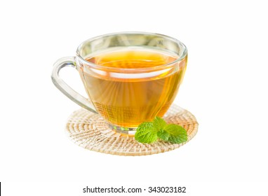 A cup of tea on wood saucer with white isolated background and copy space. Concept to present healthy beverage with mint leave and pure honey in ingredient can use for wallpaper decor or web design.