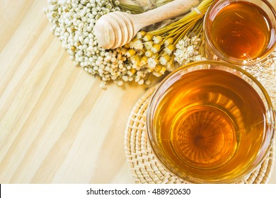 A cup of tea on the wood table. You can apply for background,backdrop,wallpaper including website decor and everything about tea artwork design.