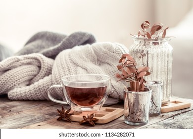 a cup of tea on a wooden table, the concept of autumn and home comfort