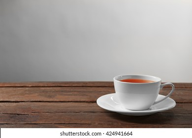 Cup of tea on wooden table