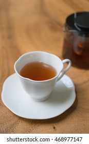 Cup of tea on wooden table. shallow depth of field
