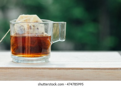 Cup of tea on wooden table.