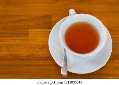 Cup of tea on wooden table. Top view - Shutterstock ID 511833313