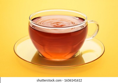 Cup of tea on a yellow background.