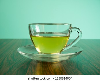 Cup of tea placed on a table in a blue background.