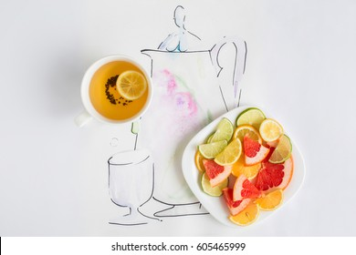 Cup of tea, a plate with slices of lemon, grapefruit, and orange and drawn teapot with glass isolated on white background