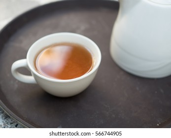 cup of tea and pot, natural warm drink for healthy life style