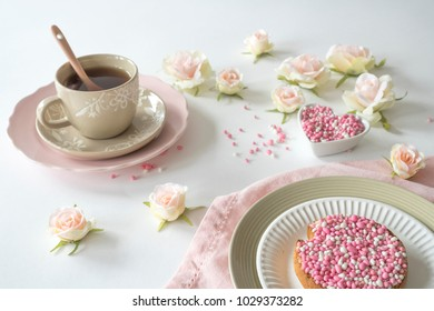 cup of tea and rusk with traditional Dutch food pink muisjes, aniseed, for celebration birth of a daughter