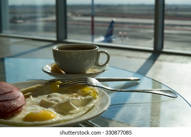 Cup of tea,scrambled eggs and sausage in airport's business lounge while waiting for the flight