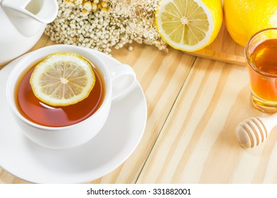 A cup of tea serving with lemon,ginger,mint and honey on the wood table. You can apply for background,backdrop,wallpaper including website decor and artwork design.