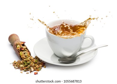 cup of tea with splashing and tea mixture in wooden scoop, on white background