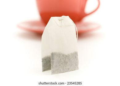Cup of tea and teabag on white background