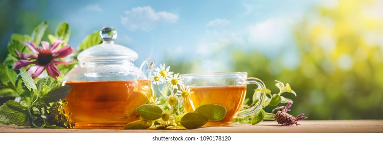 Cup of tea and teapot on table,natural background