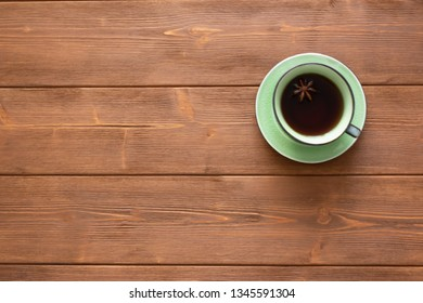 A Cup of tea with a tub on a wooden background.