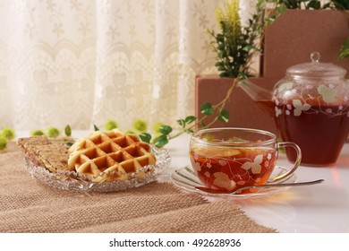 A cup of tea with waffles