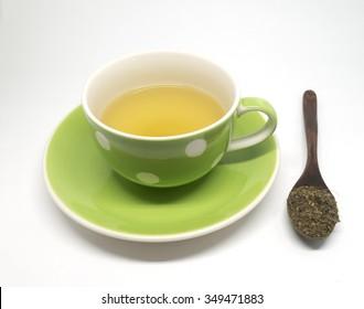 Cup of tea with wood tea spoon.