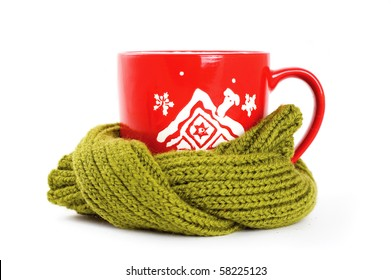 cup of tea wrapped in green scarf