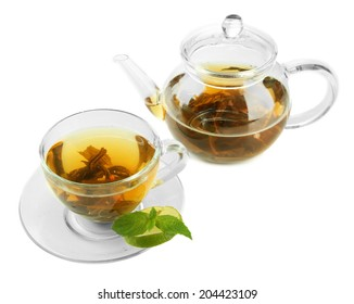 Cup and teapot of green tea isolated on white