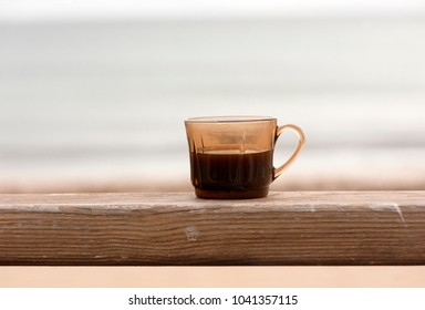 a cup of turkish coffee on wooden stand, closeup