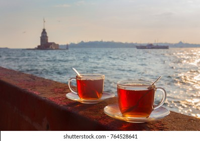A cup of Turkish tea against the background of the Maiden Tower, Turkey, Istanbul