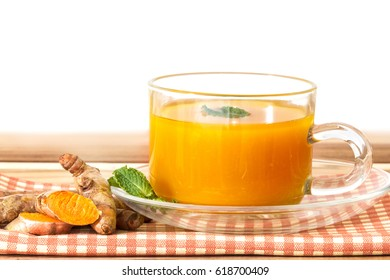 a cup of Turmeric Tea , Benefits for reduce Inflammation , Liver Detox and Cleanser healthy herb drink concept