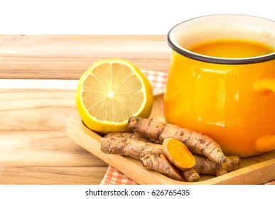 a cup of Turmeric Tea with lemon and ginger , Benefits for reduce Inflammation , Liver Detox and Cleanser healthy herb drink concept