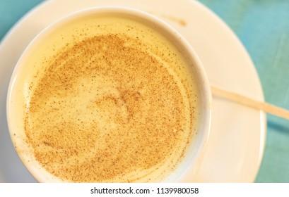 A cup of turmeric tea/latte
