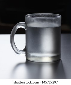 a cup of water, centered, stylized