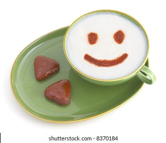 a cup of white coffee with smile and two gingerbread cookies; should help to start your day :)