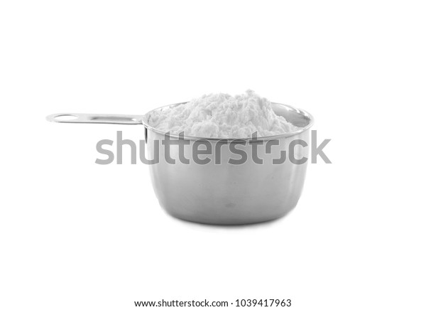 A cup of white flour isolated on white background.