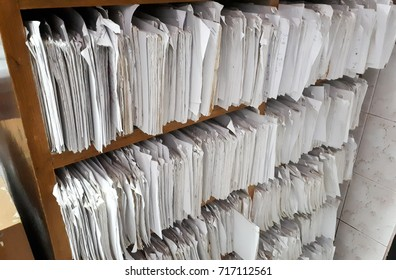 A cupboard full of paper files / inefficiency of paper based filing system