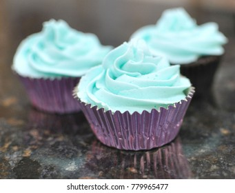Cupcake with blue buttercream icing