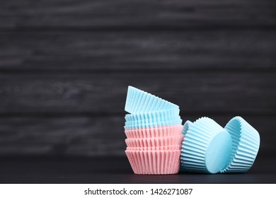 Cupcake cases on black wooden table