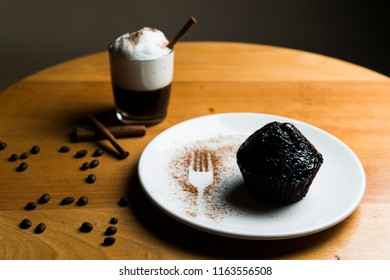 Cupcake and coffee Tasty chocolate cupcakes on wooden board. Cup of coffee. Geyser coffee maker.